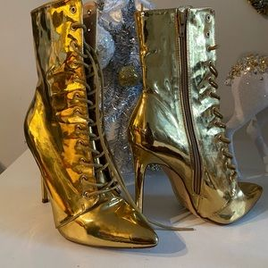 Royalty gold knee high boots